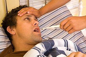 Mann krank Fiebermessen