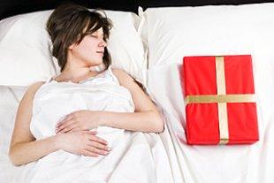 Schwangere Weihnachten Bett