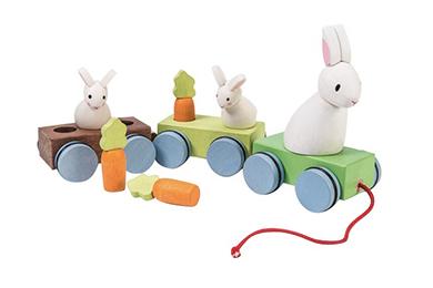 Holz-Eisenbahn mit Kaninchen